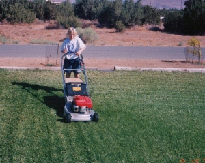 My daughter mowing the front lawn at age 11