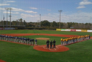 Opposing teams line up for the playing of the National Anthem