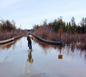 Spring thaws flood the causeway to Pushaw Lake in Maine.